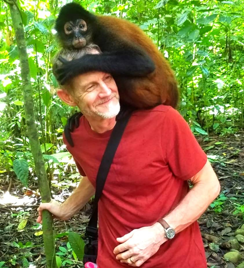Man with monkey on shoulders