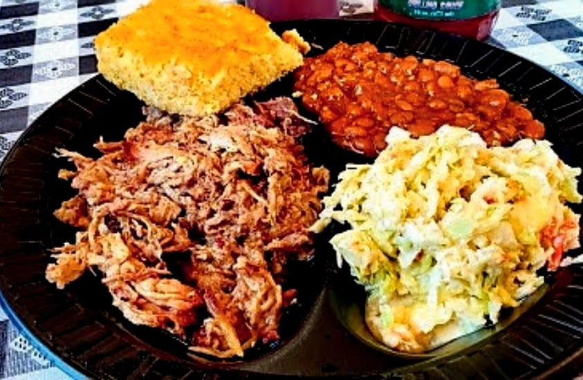 A plate of BBQ, beans, coleslaw and cornbread from Smokey Dave's BBQ