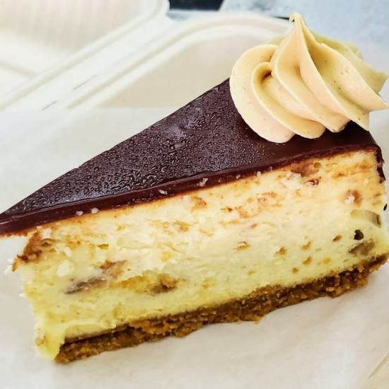 Slice of Peanut Butter Chocolate Cheesecake Custom Confections Cary NC